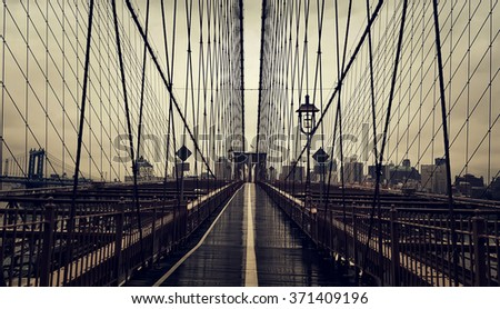 None on Brooklyn Bridge in New York City, Manhattan closeup with skyscrapers and city skyline over Hudson River. - stock photo
