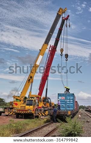 NONG KHAI, THAILAND - August 21, 2015: Crane Truck Loading Container to the Train for Shipping at Nong Khai Railway Station, Nong Khai, Thailand - stock photo