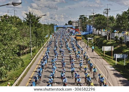 NONG KHAI, THAILAND - August 16, 2015: People ride bicycles in Bike For Mom event, purpose is to grateful to mother and respect to the Queen of Thailand on August 16, 2015 in Nong Khai, Thailand - stock photo