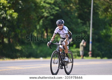 "Nong KHAI THAILAND October 30,2015:People ride bicycles in ""Ride to Khong's Legendary"", the road bicycle race through four provinces along the Mekong River, from Oct 29 to Nov 1 in NongKhai,Thailand - stock photo"