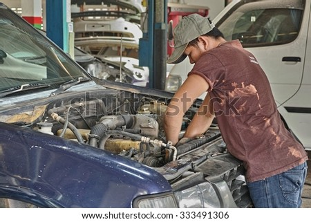 NONG KHAI, THAILAND - October 30, 2015: Worker repair pickup car in the garage in Nong Khai, Thailand