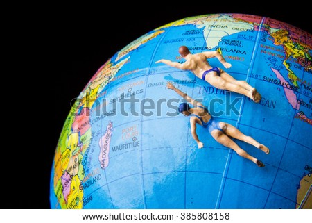 Nonthaburethailanddecember132015tiny toy swimming on globe world by bubbers bb gumiabroncs Images
