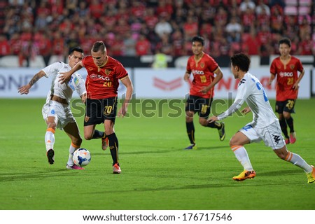 NONTHABURI-FEB 8,Mario Gjurovski(R)of MTUTD UTD runs for the ball during football AFC Champions League 2014 between SCG Muangthong utd and Hanoi T&T at SCG Stadium on February 8,2014 in Thailand   - stock photo