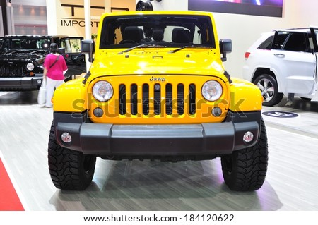 NONTHABURI - March 25: New Jeep Wrangler Sahara on display at The 35th Bangkok International Motor show on March 25, 2014 in Nonthaburi, Thailand. - stock photo