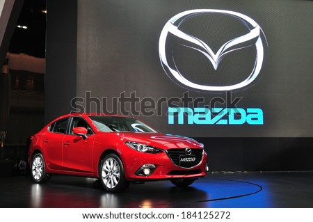 NONTHABURI - March 25: New Mazda 3 on display at The 35th Bangkok Thailand International Motor Expo on March 25, 2014 in Nonthaburi, Thailand. - stock photo