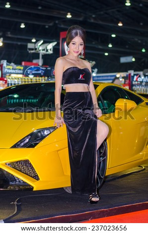 NONTHABURI - NOVEMBER 28:   Lamborghini car with Unidentified model on display at Thailand International Motor Expo 2014 on November 28, 2014 in Nonthaburi, Thailand. - stock photo