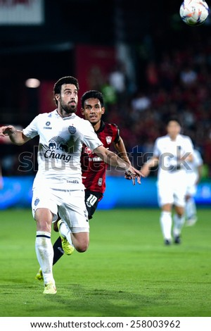 NONTHABURI THAI-FEB 21:Andres Tunez#5 of Buriram Utd.Looking at the football during the Thai Premier League between SCG Muangthong UTD. and Buriram UTD.at SCG Stadium on February 21,2015 in,Thailand - stock photo