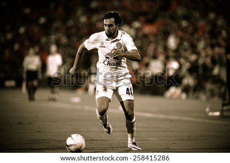 NONTHABURI THAI-FEB 21:Diogo Luis Santo of Buriram Utd.runs for the ball during the Thai Premier League 2015 between SCG Muangthong UTD. and Buriram UTD.at SCG Stadium on February 21,2015 in,Thailand - stock photo