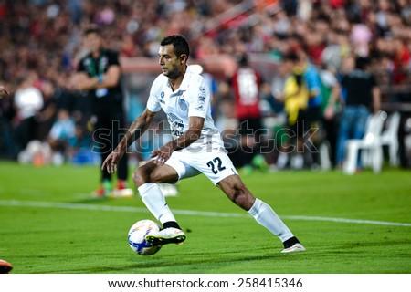 NONTHABURI THAI-FEB 21:Gilberto Macena of Buriram Utd.contols the ball during Thai Premier League 2015 between SCG Muangthong UTD. and Buriram UTD.at SCG Stadium on February 21,2015 in,Thailand - stock photo