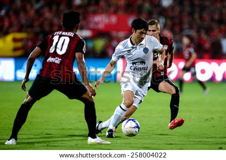 NONTHABURI THAI-FEB 21:Go Seul-ki #7 of Buriram Utd.in action during Thai Premier League between SCG Muangthong UTD. and Buriram UTD.at SCG Stadium on February 21,2015 in,Thailand - stock photo