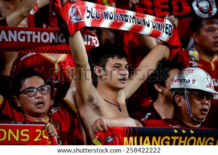 NONTHABURI THAI-FEB 21:SCG Muangthong United fans cheer on their team prior to the Thai Premier League 2015 between SCG Muangthong UTD. and Buriram UTD.at SCG Stadium on February 21,2015 in,Thailand - stock photo