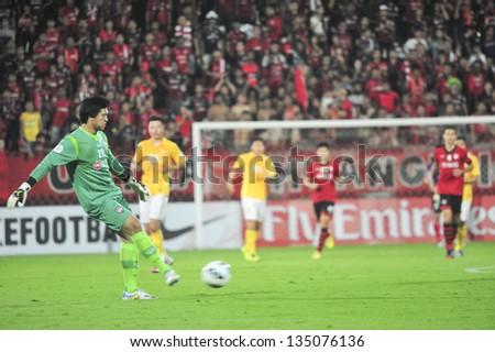 NONTHABURI, THAILAND- APRIL 9 : A.Daosawang (G) in action during AFC Champions  League 2013  Between Muangthong Utd (R) VS Guangzhou Evergrande (Y) on April 9, 2013 at SCG Stadium, Bangkok, Thailand - stock photo