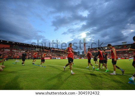 NONTHABURI THAILAND- AUG 9: Players of Muangthon Utd warming before match start in action during the Thai Premiel League 2015 beween MTUTD and BGFC at SCG Stadium on August 9, 2015 in Thailand. - stock photo