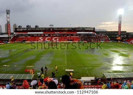 NONTHABURI THAILAND-AUGUST18:Unidentified fan watch a view SCG Stadium  during heavy rain before the match between SCG Muangthong utd.and Buriram utd.on Aug18,2012 inThailand they postponed the match