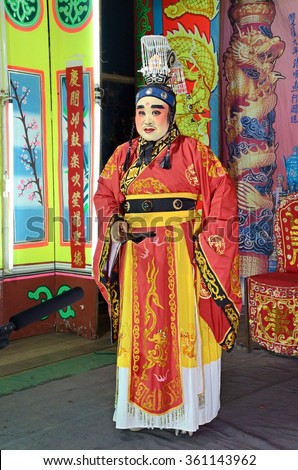 Nonthaburi, THAILAND - Feb 23, 2012: Actors (Unidentified) appear in a free admission public showing of Chinese opera on a street in Pak Kret District.