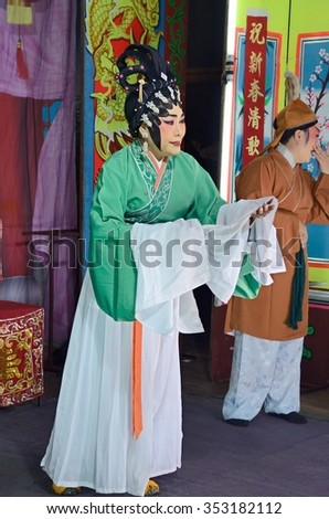 Nonthaburi, THAILAND - FEB 23: Actors (Unidentified) appear in a free admission public showing of Chinese opera on a street in Pak Kret District on Feb 23, 2012, in Nonthaburi Province, Thailand. - stock photo
