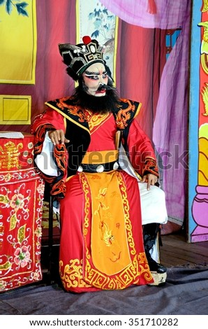 Nonthaburi, THAILAND - FEB 23, 2012: Actors Unidentified appear in a public showing of Chinese opera on a street in Pak Kret District.