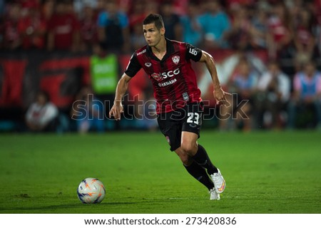 NONTHABURI THAILAND-FEBRUARY 21:	Cleiton Silva  of Muangthong utd. run with the ball during Thai Premier League between Muangthong Utd.and Buriram United at SCG Stadium on Feb 21, 2015,Thailand - stock photo