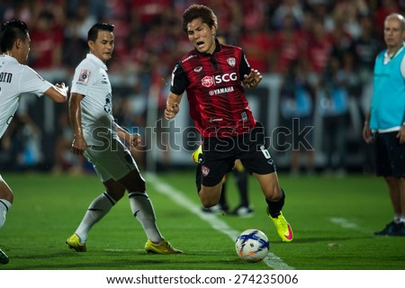 NONTHABURI THAILAND-FEBRUARY 21:	Kim Dong-Jin no.6 (RED) of  Muangthong Utd. in action during Thai Premier League between Muangthong Utd.and Buriram United at SCG Stadium on Feb 21, 2015,Thailand - stock photo