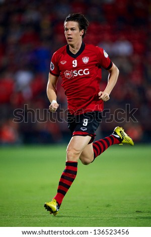 NONTHABURI,THAILAND-FEBRUARY 26:		Roland Linz of  Muanthong Utd. in action during the AFC Champions League between Muangthong Utd. and Jeonbuk at SCG Stadium on Feb 26,2013 in,Thailand.