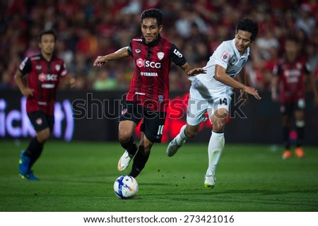 NONTHABURI THAILAND-FEBRUARY 21:Teerasil Dangda (L) of Muangthong utd. in action during Thai Premier League between Muangthong Utd.and Buriram United at SCG Stadium on Feb 21, 2015,Thailand - stock photo