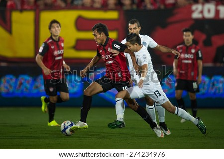 NONTHABURI THAILAND-FEBRUARY 21:	Teerasil Dangda (RED) of  Muangthong Utd. in action during Thai Premier League between Muangthong Utd.and Buriram United at SCG Stadium on Feb 21, 2015,Thailand - stock photo