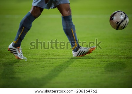 NONTHABURI THAILAND-Jul02:Goalkeeper during the close up of a soccer shoe during  Toyota League Cup between SCG Muangthong Utd and Buriram United at SCG Stadium on July02,2014,Thailand