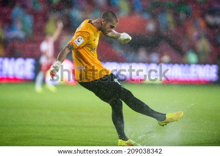 NONTHABURI THAILAND-Jul30:Goalkeeper Ruben of Almeria. hit the ball during  the LFP World Challenge 2014 between SCG Muangthong UTD. and Almeria at SCG Stadium on July30,2014,Thailand - stock photo
