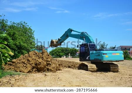 NONTHABURI, THAILAND - JUNE 9 : BackHoe Excavator Machine working at construction Site on June 9, 2015 in Nonthaburi, Thailand.  - stock photo