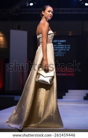 NONTHABURI THAILAND- MARCH 12: A model  pose on stage at the Let's Party show during BIFF&BIL Bangkok international Fashion Fair 2015 at IMPACT Challenger Hall on March 12,2015 in,Thailand - stock photo