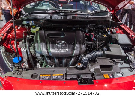 Nonthaburi,Thailand - March 26th, 2015: Engine of all New Mazda2 Sedan on display ,showed in Thailand the 36th Bangkok International Motor Show on 26 March 2015 - stock photo
