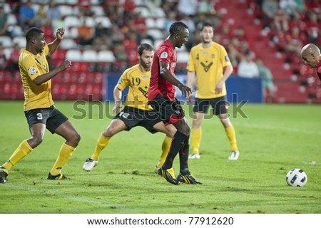 NONTHABURI, THAILAND - MAY 25 : D.Saika (red) in action during the AFC CUP between Muang Thong UTD vs Al Ahed Fc on May 25, 2011 at Yamaha Stadium in Nonthaburi, Thailand