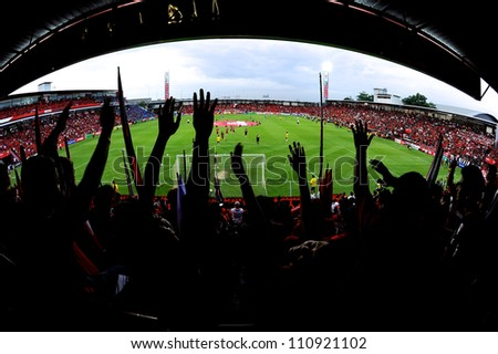 NONTHABURI THAILAND-MAY 27:Unidentified SCG MuangThong utd.supporters during Thai Premier League between SCG Muangthong Utd.and Chonburi F.C. on May27,2012 in Nonthaburi,Thailand - stock photo