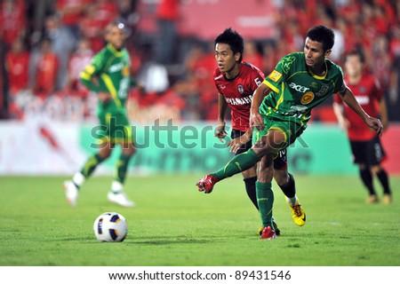 NONTHABURI THAILAND-NOV 22   JAKRAPONG SOMBOON of Army Utd. in action during Thai Premier League between Muangthong Utd.(R)and Army Utd.(G)on Nov 22,2011 at Yamaha Stadium Nonthaburi,Thailand - stock photo