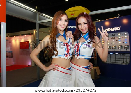 Nonthaburi, Thailand - November 28, 2014: Unidentified model  with RAYBRIG pose in the 31th  Thailand International Motor Expo on November 28, 2014 in Nonthaburi, Thailand.