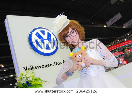 Nonthaburi, Thailand - November 29, 2014: Unidentified model  with Volkswagen pose in the 31th  Thailand International Motor Expo on November 29, 2014 in Nonthaburi, Thailand.