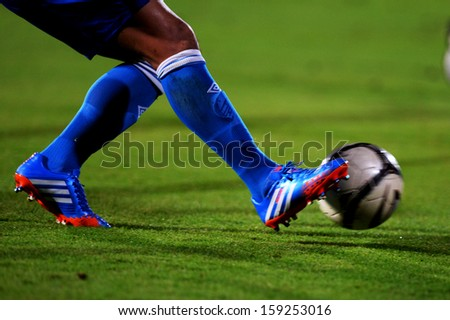 NONTHABURI THAILAND-OCT20:goalkeeper knocks the ball during Thai Premier League between SCG Muangthong Utd.and Bangkok Glass FC.at SCG Stadium on OCTOBER20,2013 in,Thailand  - stock photo