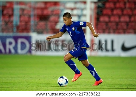 NONTHABURI THAILAND-SEPTEMBER 08:Adisak Narattho of Thailand run with the ball during the AFC U-16 Championship between Thailand and Oman at Muangthong Stadium on Sep 08, 2014,Thailand