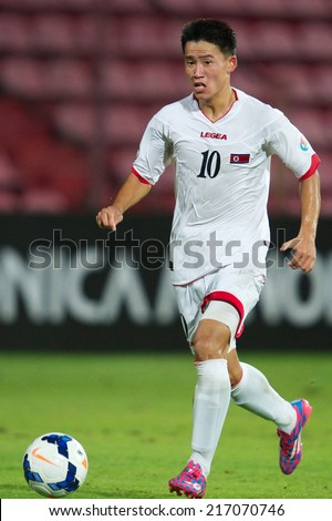 NONTHABURI THAILAND-SEPTEMBER 07:Choe Song Hyok of DPR Korea run with the ball during the AFC U-16 Championship between Kuwait and DPR Korea at Muangthong Stadium on Sep 07, 2014 ,Thailand