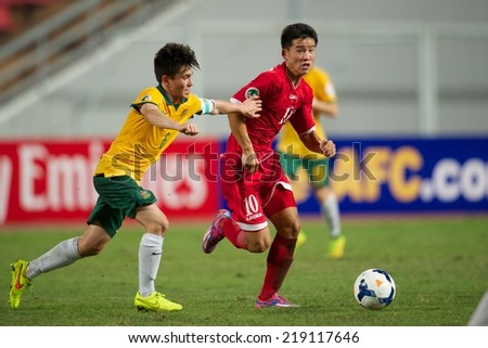 NONTHABURI THAILAND-SEPTEMBER 17:Choe Song Hyok (R) of DPR Korea run with the ball during the AFC U-16 Championship between Australia and DPR Korea at  Rajamangala Stadium on Sep17,2014,Thailand