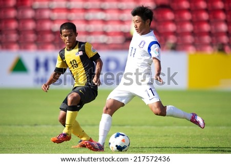 NONTHABURI THAILAND-SEPTEMBER 08:Jang Gyeolhee no.11 (white)of Korea Republic in action during the AFC U-16 Championship Korea Republic and Malaysia at Muangthong Stadium on Sep08,2014,Thailand