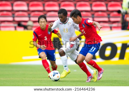 NONTHABURI THAILAND-SEPTEMBER 06:Luai Salim Rabia Al-Hadidi (white) of Oman in action during the AFC U-16 Championship between Korea Republic and Oman at Muangthong Stadium on Sep 06, 2014, Thailand