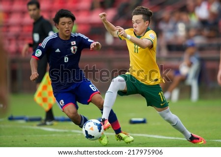NONTHABURI THAILAND-SEPTEMBER 10:Peter Kekeris #11 (R)of Australia in action during the AFC U-16 Championship between Australia and Japan at Muangthong Stadium on Sep10 ,2014,Thailand