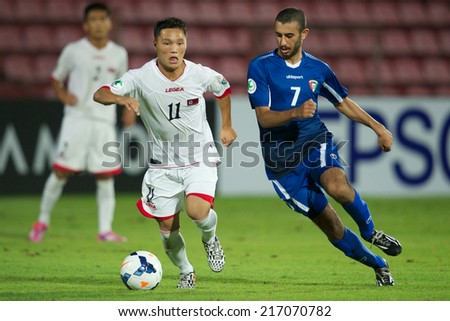 NONTHABURI THAILAND-SEPTEMBER 07:Salem W S H S Albariki (blue) of Kuwait in action during the AFC U-16 Championship between Kuwait and DPR Korea at Muangthong Stadium on Sep 07, 2014 ,Thailand