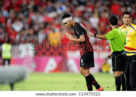 NONTHABURI THAILAND-SEPTEMBER 9:Teerasil Dangda (red) of SCG Muangthong Utd.in action during Thai Premier League between SCG Muangthong utd.and Wuachon utd. on September 9,2012 in ,Thailand