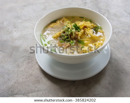 noodle clear soup with egg for healthy in white bowl - stock photo