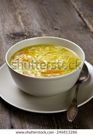 noodle soup in a bowl on a wooden background - stock photo
