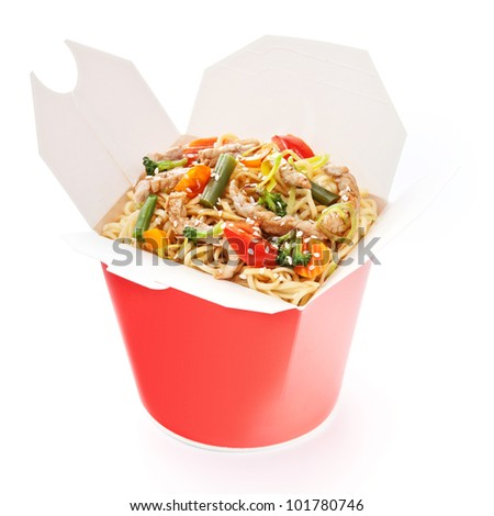 Noodles with pork and vegetables in take-out box on white background - stock photo