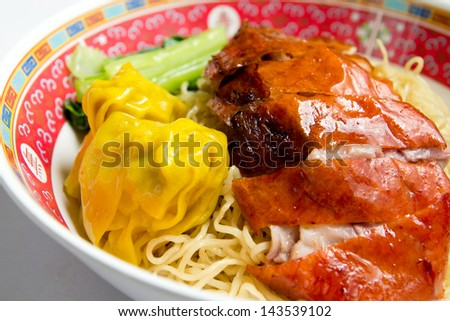 Noodles with roasted duck and dumpling and chinese cabbage. - stock photo