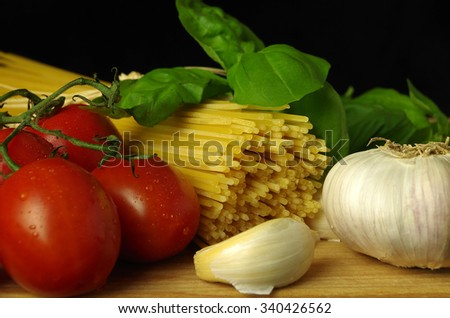 Noodles with tomato, basil and garlic - stock photo
